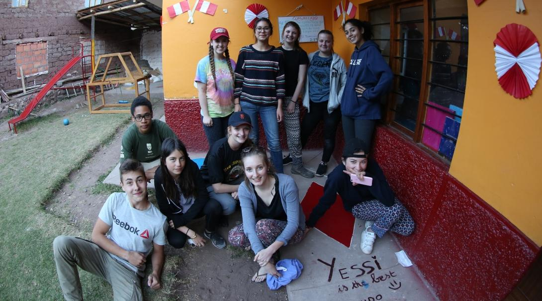 Teenage volunteers doing work with children in Peru, take a break during the day.